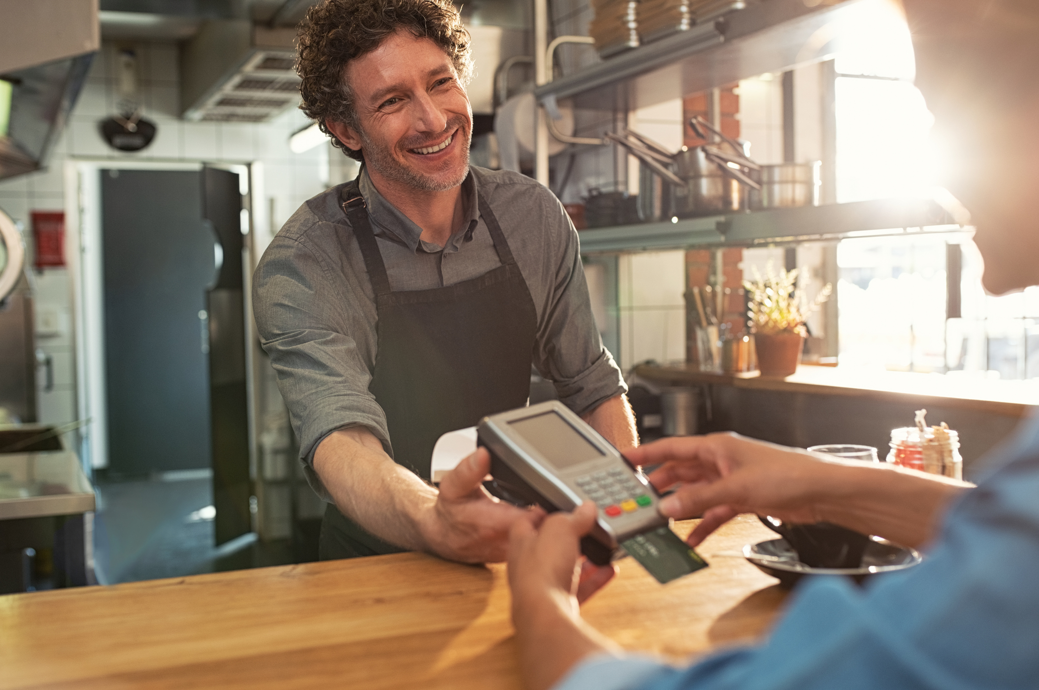 waiter accepting point of sale pos payment
